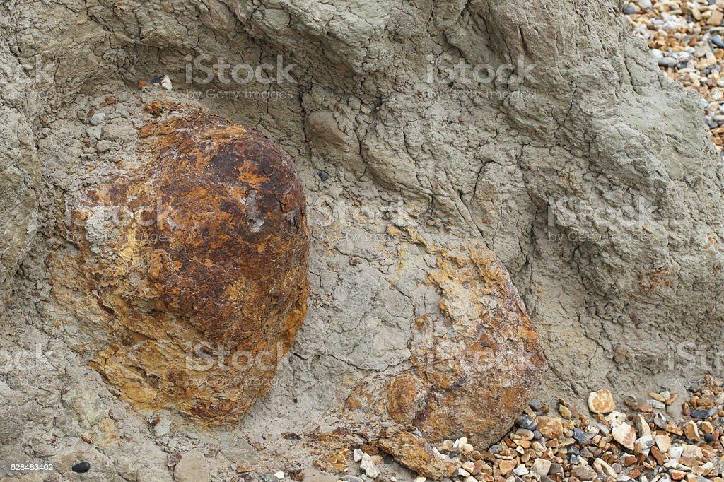 Ironstone outcrop in clay cliff at Hengistbury Dorset England stock photo