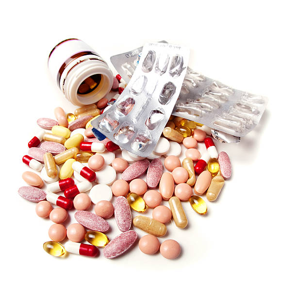 "Irrational drug use ""Empty blister packs, pill bottle and large group of spilled pills (vitamin pills, antibiotics, tranquilizers, antidepressants, antipyretics etc). Irrational drug use  is a major problem worldwide."" antipyretic stock pictures, royalty-free photos & images"