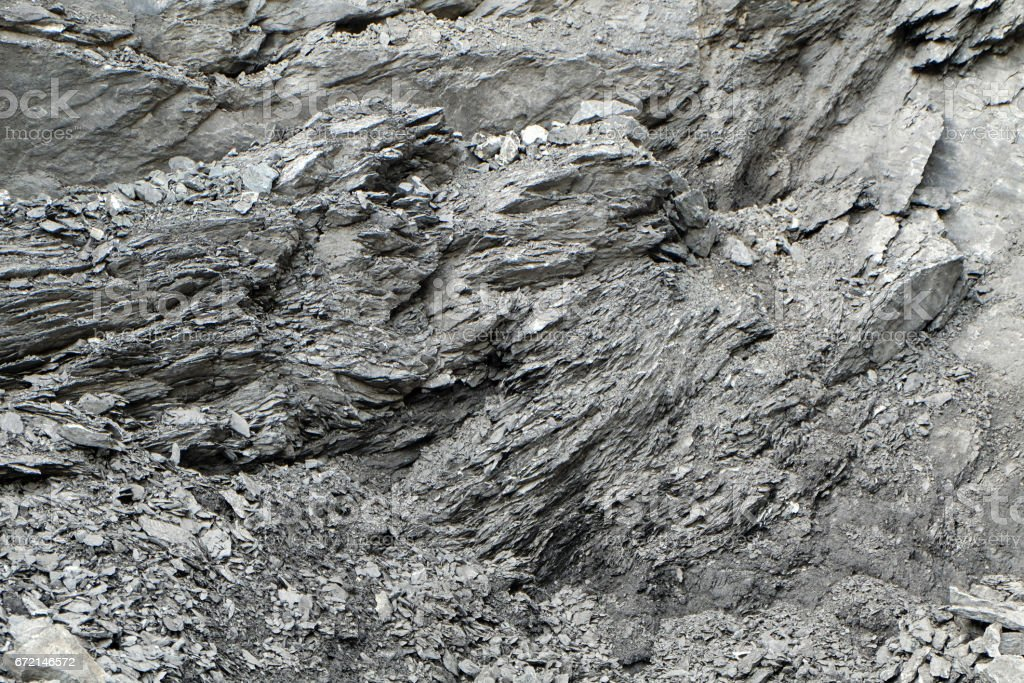 irregular pattern of a rock face at a quarry stock photo