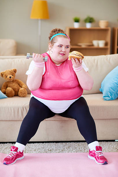 irresistible temptation - funny fat lady stock photos and pictures