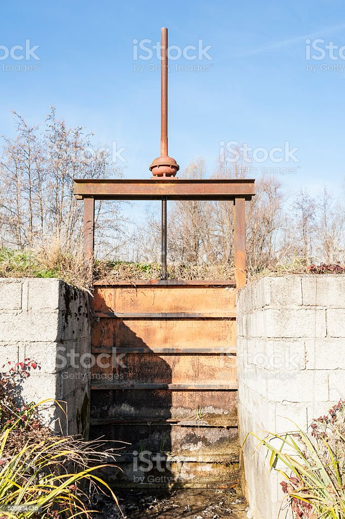 Irrigation Canal and Floodgate valve stock photo