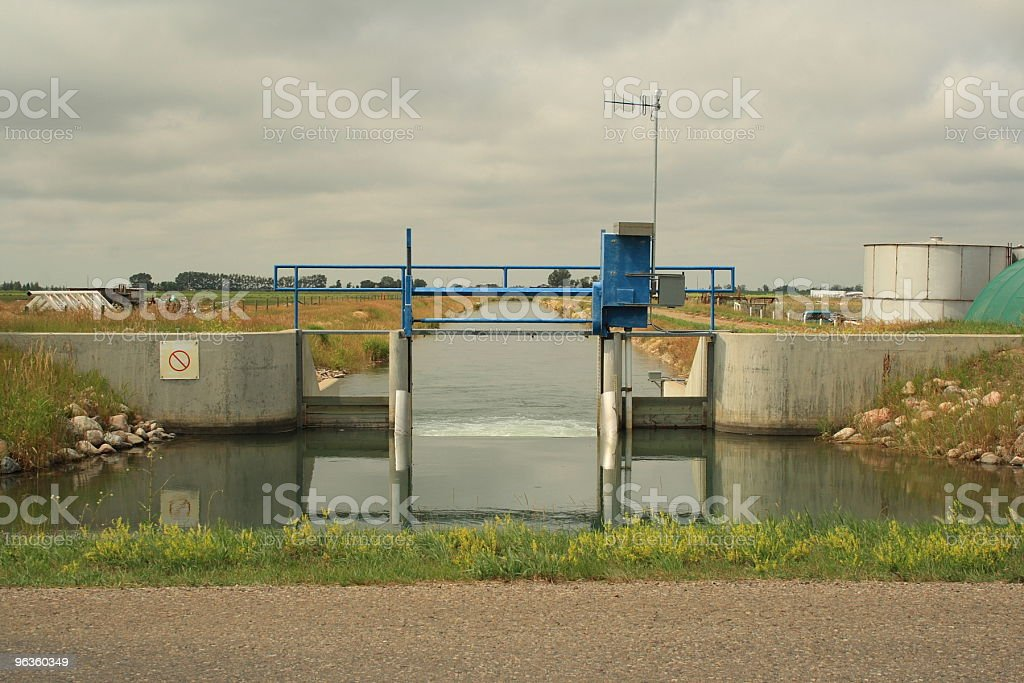 irrigation canal aquaduct gate on the prairies royalty-free stock photo