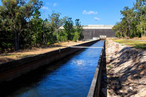Irrigation channel for farming at Tinaroo Falls Dam on the Atherton Tablelands, Queenslandm, Australia, with low water due to drought. stock photo