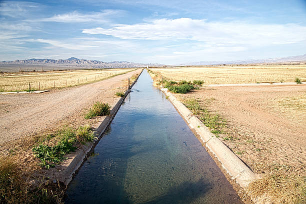 Irrigation Ditch with Flowing Water stock photo