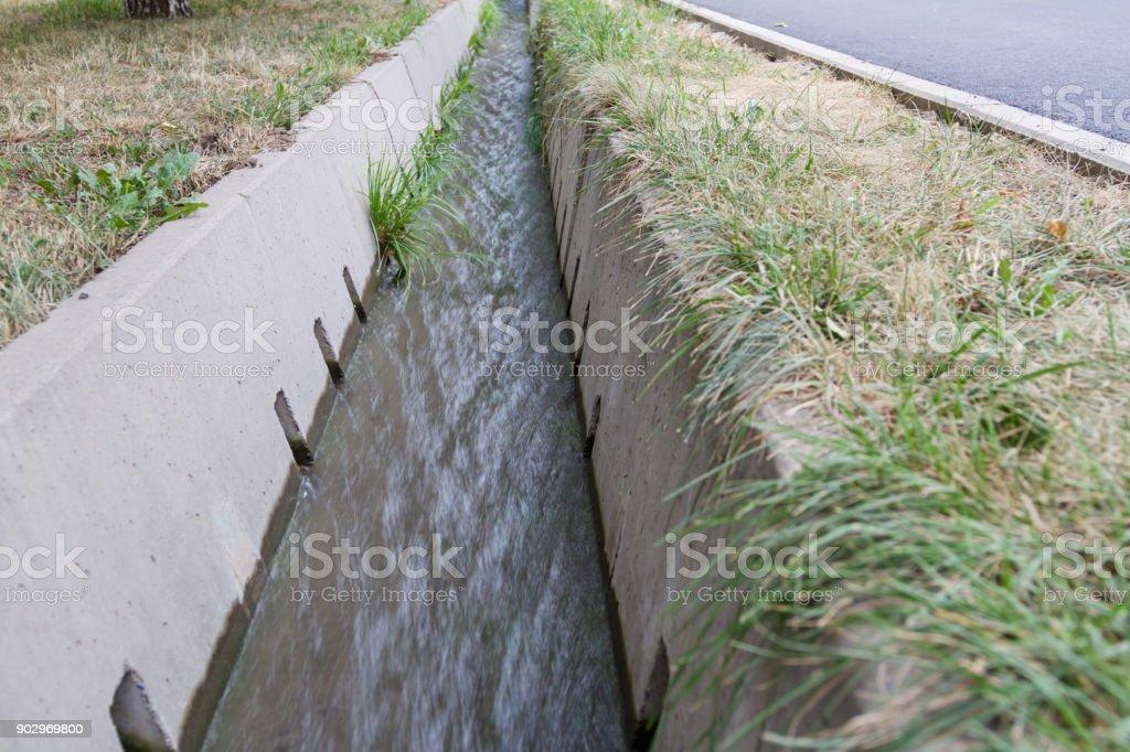 irrigation ditch with water stock photo