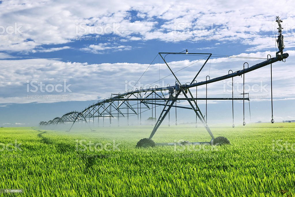 Irrigation equipment on farm field royalty-free stock photo