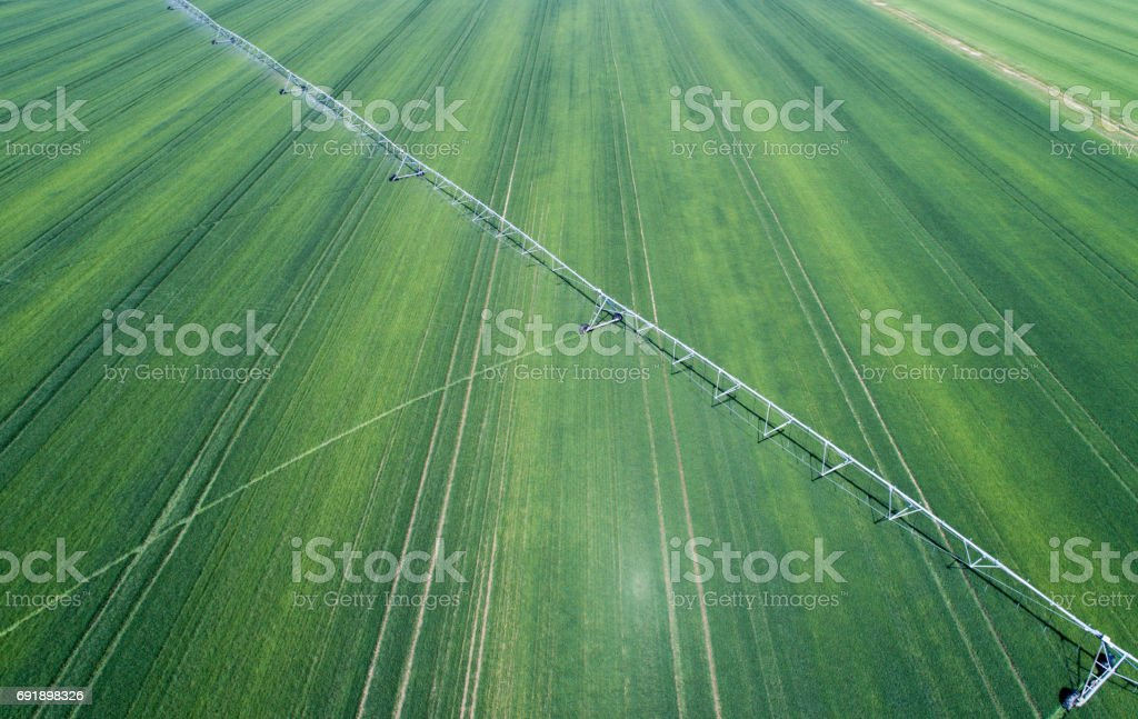 Irrigation system in field stock photo