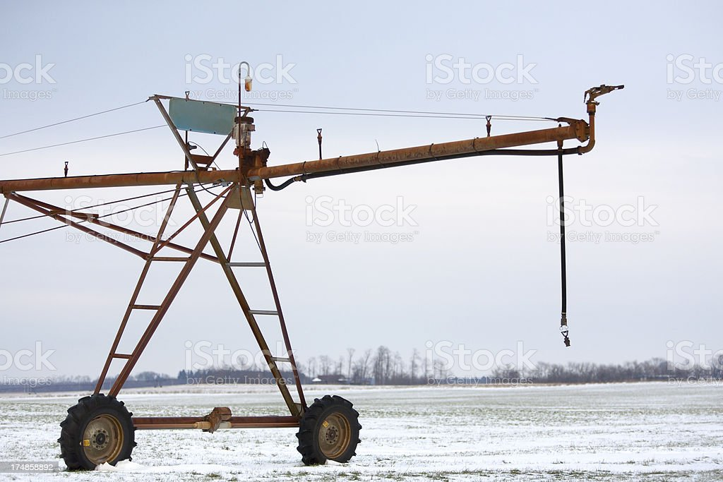 irrigation system in snowy field royalty-free stock photo