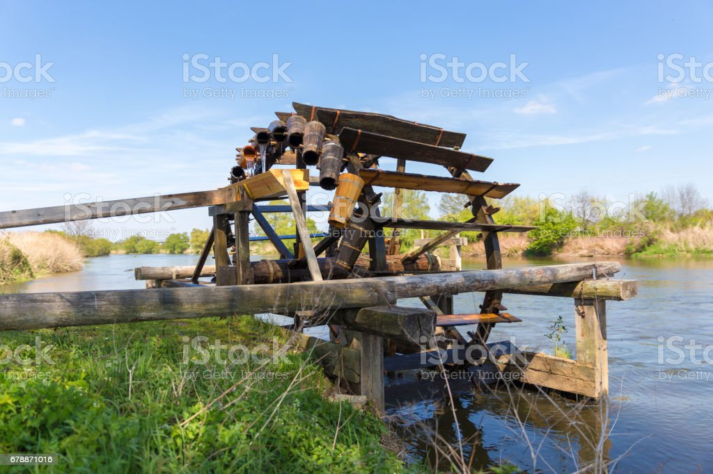 irrigation water wheel in germany stock photo
