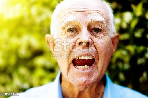 661896674istockphoto Irritated and tetchy, old man shouts angrily 618209674
