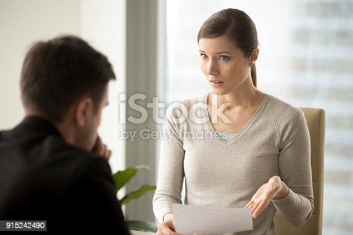 istock Irritated businesswoman disagree with bad contract, boss dissatisfied with report 915242490