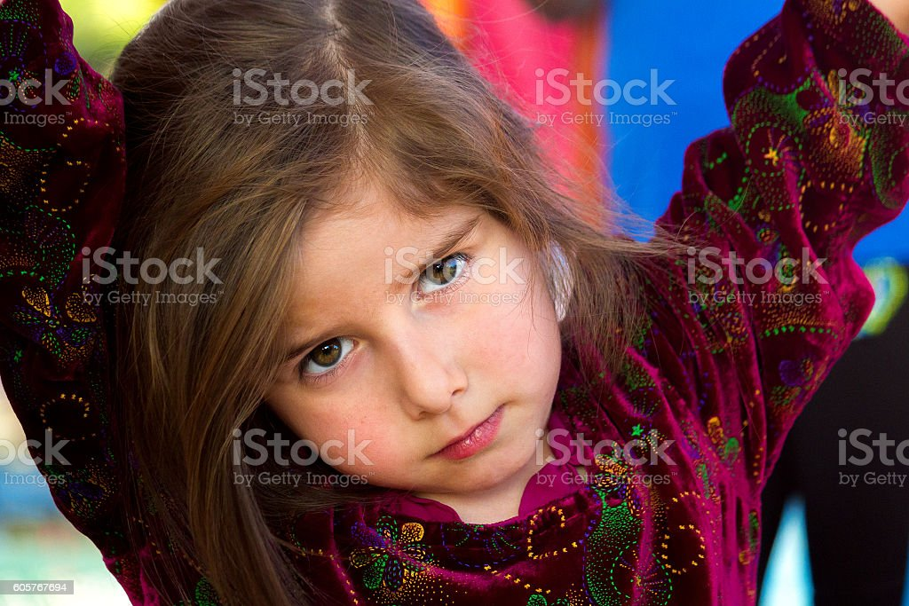Irritated Little Girl Stares Down Viewer stock photo