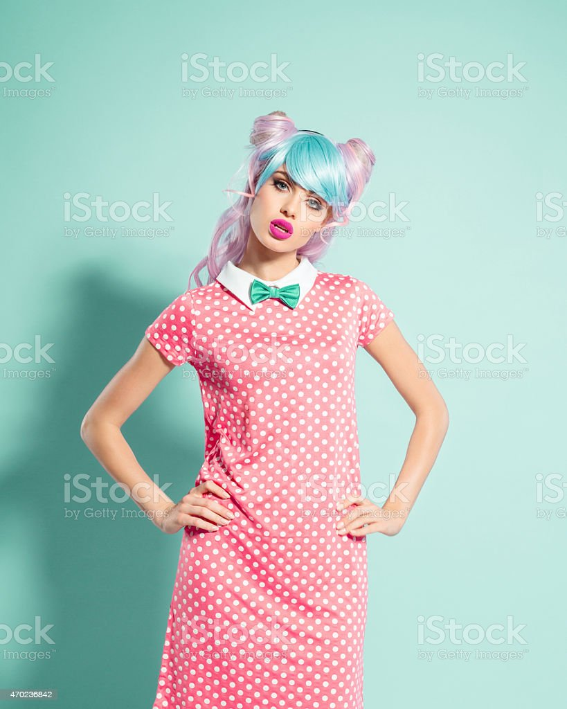 Irritated pink hair manga style girl stock photo
