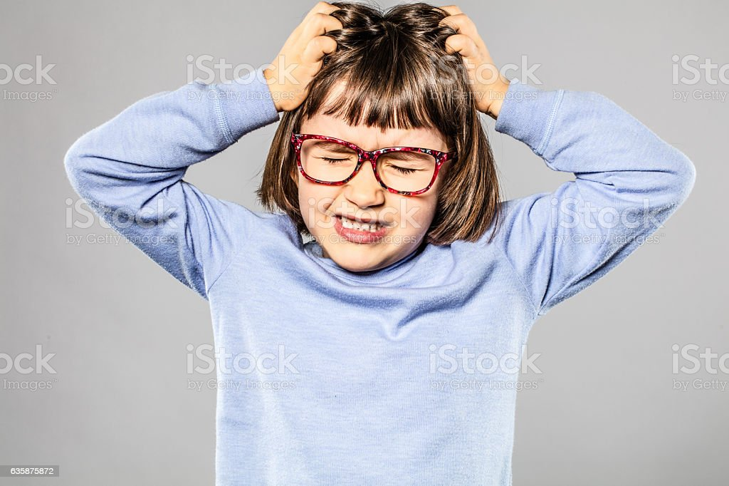 irritated young girl pulling out hair for itchy lice allergies stock photo