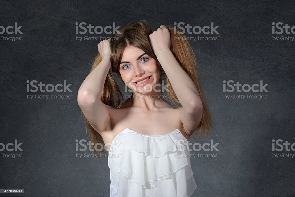 Irritation, anger, jealousy concept. Woman holds her hair stock photo