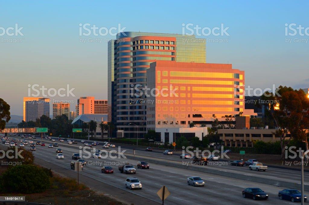 Irvine city skyline and freeway at sunset stock photo