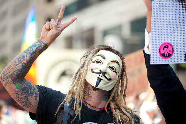 v is for bradley manning - guy fawkes mask stock photos and pictures