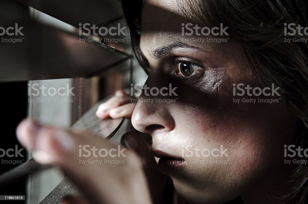 Is he home? ; domestic abuse concept stock photo