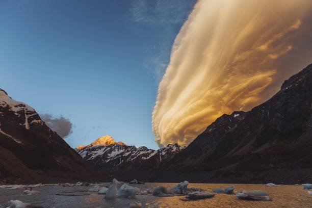 Is it a UFO or a lenticular cloud? mount cook always delivers for photographers lenticular cloud stock pictures, royalty-free photos & images