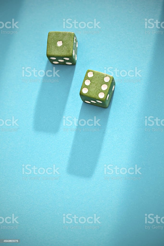 7 is lucky, green unlucky: confusing dice throw! royalty-free stock photo