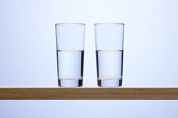 Is the glass half full or empty? stock photo