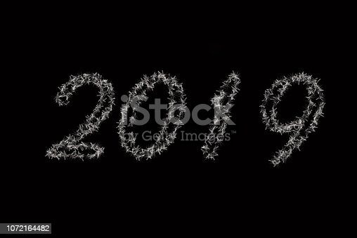istock 2019 is written with snow . Black background 2019 article . White 2019 New Year of on black background . Happy New Year Card design, web banner template, poster, postcard, lettering background 1072164482