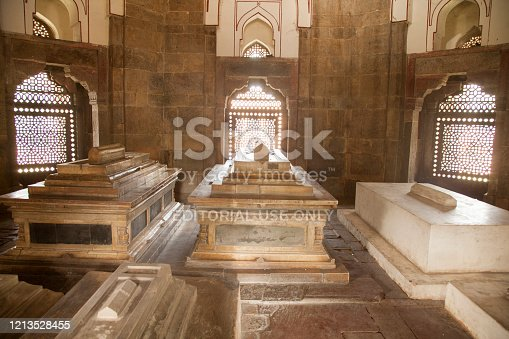 New Delhi, India - Ottobre 30,2016:  Isa Khan Niyazi's Tomb part of the Humayun's tomb complex. Humayun's tomb is the tomb of the Mughal Emperor Humayun in Delhi, India. The tomb was commissioned by Humayun's first wife and chief consort,  in 1569-70, and designed by Mirak Mirza Ghiyas and his son, Sayyid Muhammad,Persian architects chosen by her.  It was the first garden-tomb on the Indian subcontinent,and  is located in Nizamuddin East, Delhi, India, close to the Dina-panah Citadel. It was also the first structure to use red sandstone at such a scale. The tomb was declared a UNESCO World Heritage Site in 1993.