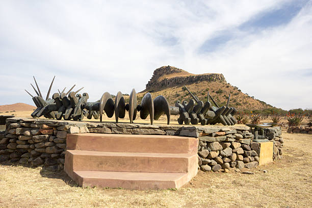 Isandlwana in KwaZulu-Natal, South Africa The Zulu monument to their victory at Isandlwana, with the hill of Isandlwana in the background battlefield stock pictures, royalty-free photos & images