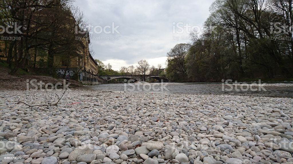 Isar river bed pebbles in Munich stock photo