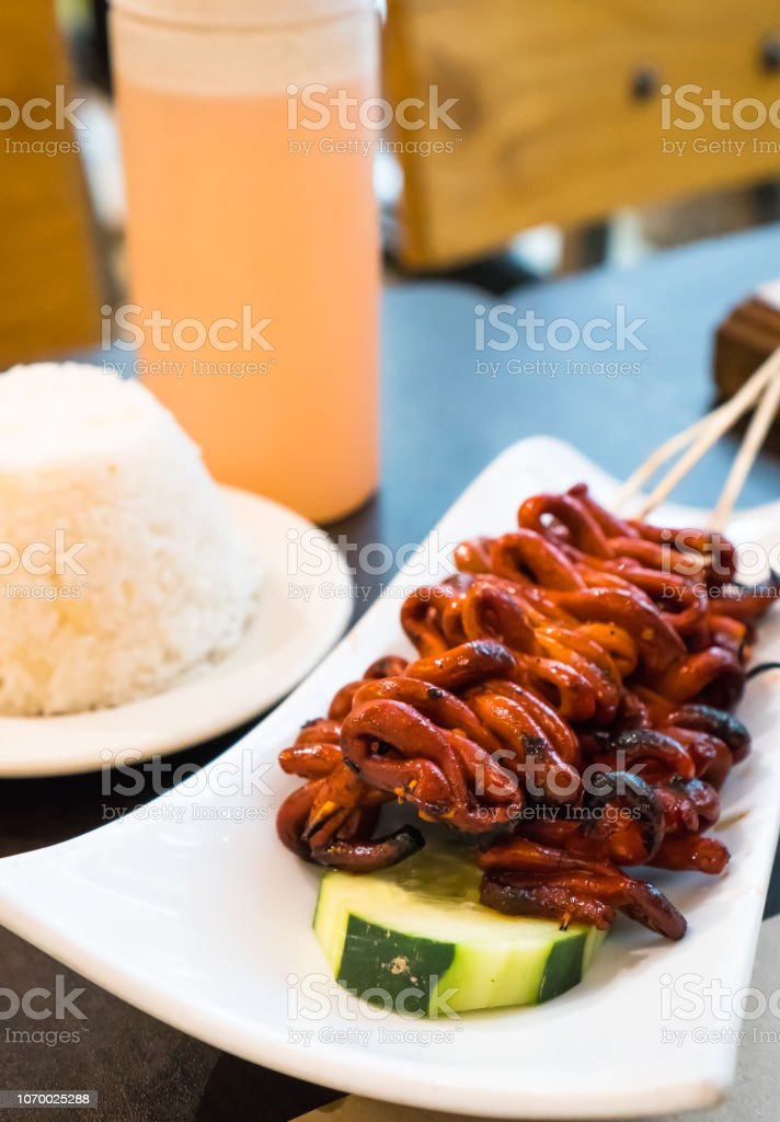 isaw or chicken intestine barbecue stock photo
