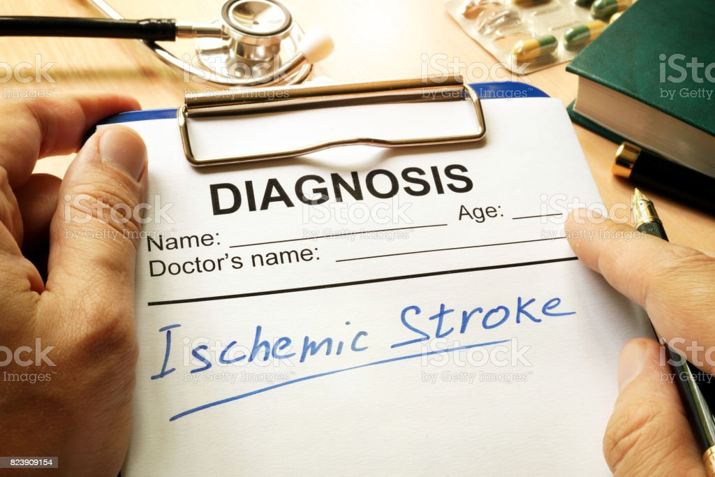 Ischemic stroke written on a diagnosis form. stock photo