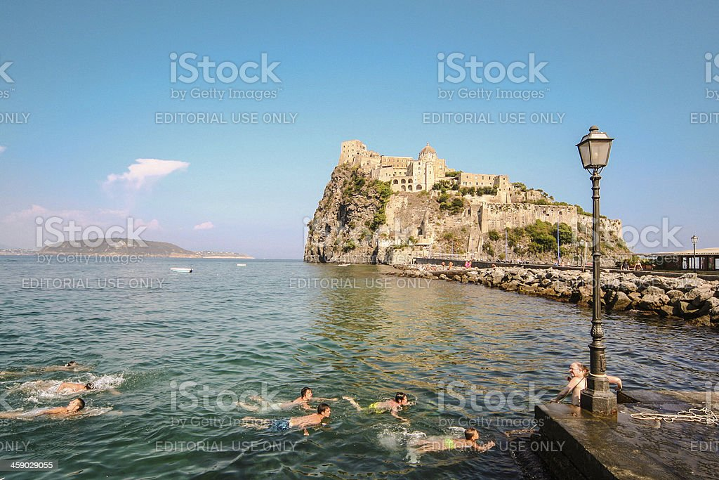 Ischia Island Castle and People Swiming royalty-free stock photo