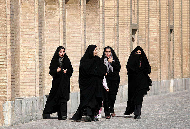 Isfahan,Iran Isfahan,Iran - February 13,2008 : Women in Iran have to wear the burqa.In Iran, women typically dresses in black.Iran women have to wear burqas tourist religious veil stock pictures, royalty-free photos & images