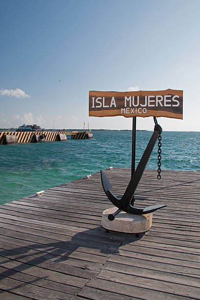 Isla Mujeres Welcome Anchor / Sign on ferry dock stock photo