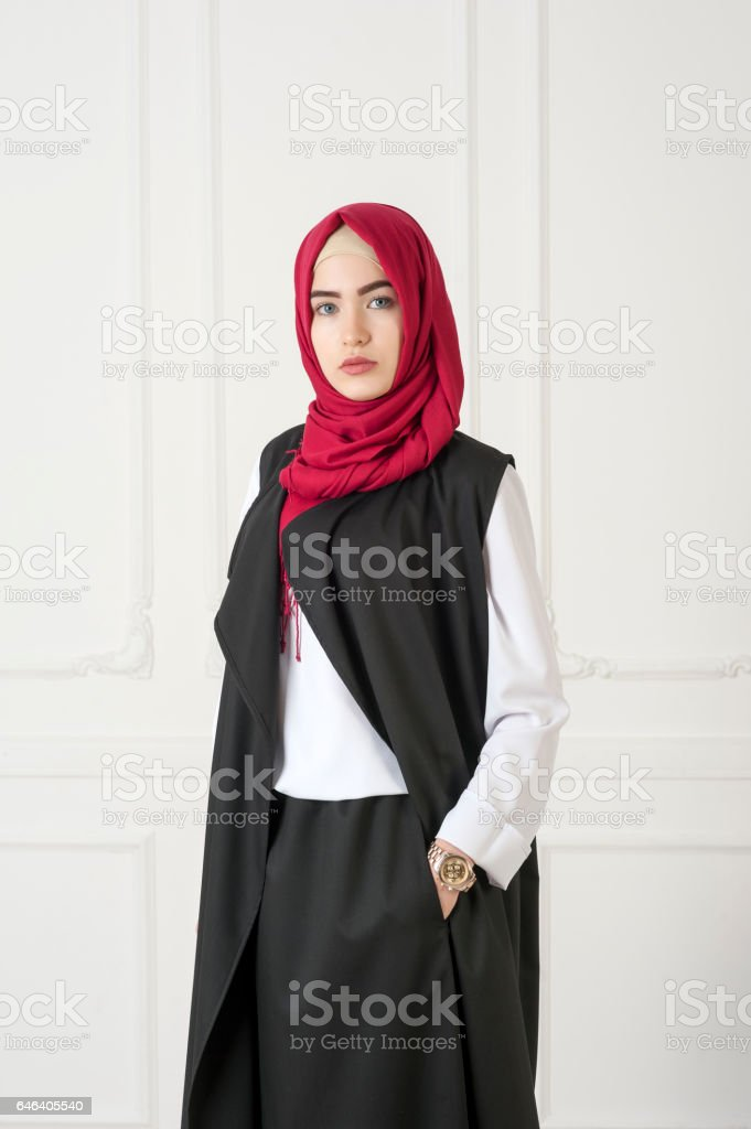 Islamic beautiful woman in a modern oriental dress, studio photo stock photo