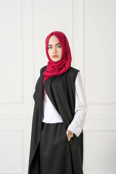 Islamic beautiful woman in a modern oriental dress, studio photo stock photo