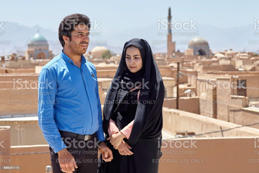 Islamic family on roof, in historic center town of Yazd. stock photo