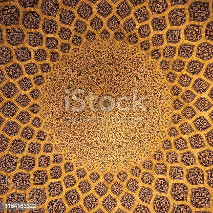 Islamic geometric pattern in Mosque. Islamic arabesque ornament on a mosque ceiling in Iran. Ornament on a dome of a mosque.