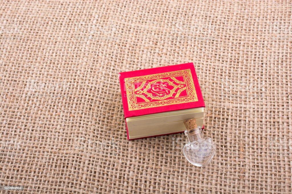 Islamic Holy Book Quran in mini size stock photo