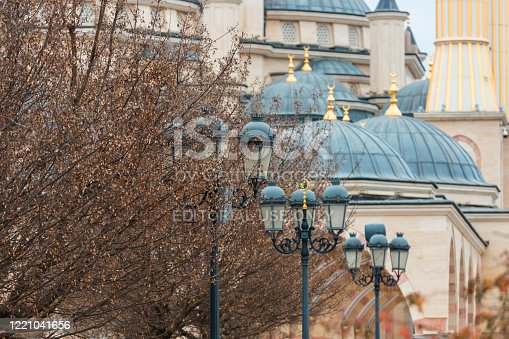 Grozny, Chechen Republic, Russia, 01.20.2020: Islamic lanterns and The Akhmad Kadyrov Mosque on the background. The Heart of Chechnya Mosque. The central city park view