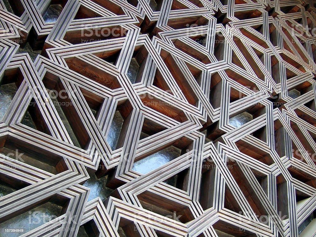 Islamic lattice pattern covering wall stock photo