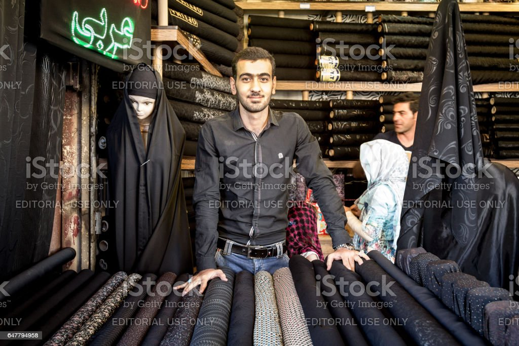 Isfahan, Iran - August 20, 2016: Islamic outfit seller (hijab, veils and scarfs) in Isfahan bazaar stock photo