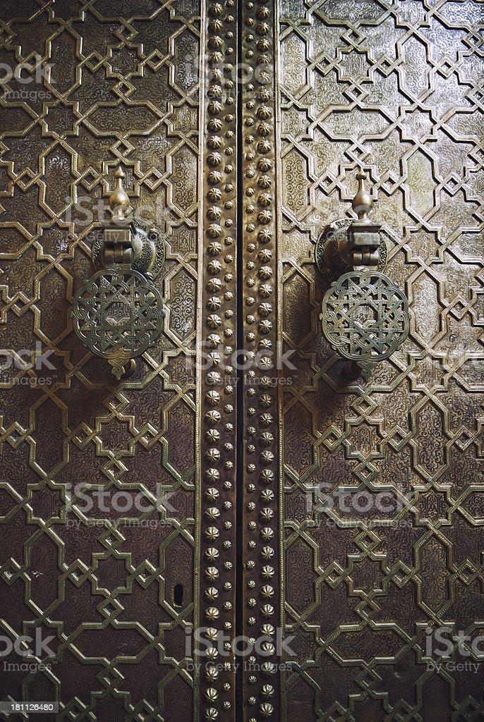 Islamic Pattern Dark Wood Door Moroccan Mosque in Fez stock photo