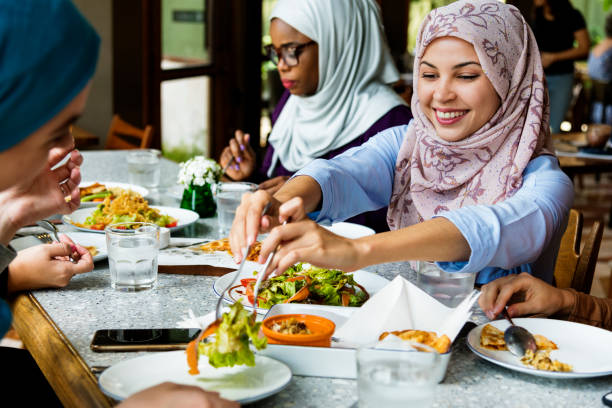 Islamic women friends dining together with happiness Islamic women friends dining together with happiness southeast asian ethnicity stock pictures, royalty-free photos & images