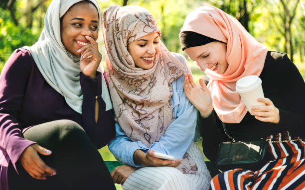 Islamic women friends talking and having fun stock photo