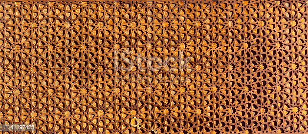 Islamic wooden ornament background. Part of wood with Arabic ornament in Bukhara, Uzbekistan, Central Asia
