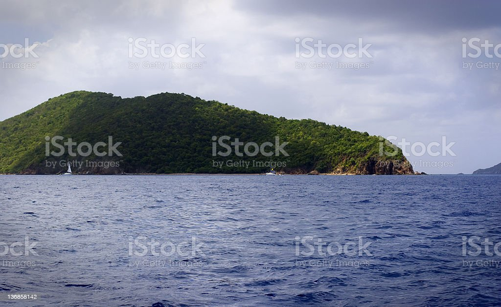 Island and Boats in the British Virgin Islands Two boats moored near one of the many islands in the BVI. Blue Stock Photo