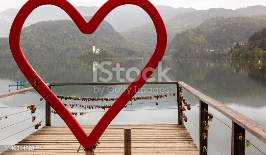 Unusual view of island at the center of Bled lake seen from love symbol