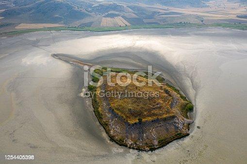 A small arid island in the middle of Yarisli (Yarışlı) Lake in Burdur, Turkey.. Taken via drone.