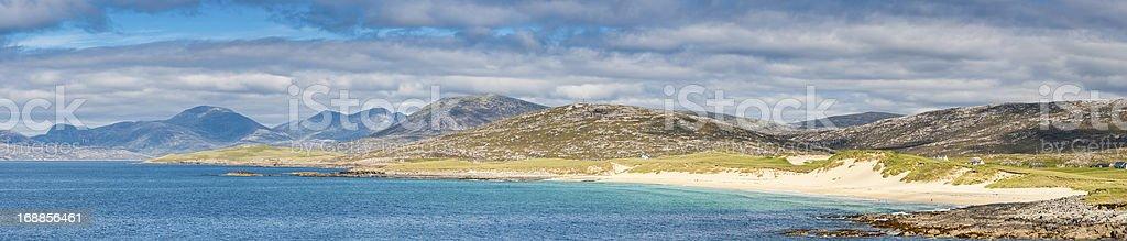 Island beach blue ocean sunlit mountains panorama Western Isles Scotland stock photo
